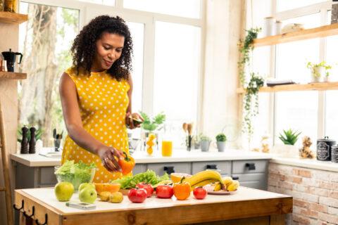 A pregnant woman preparing food